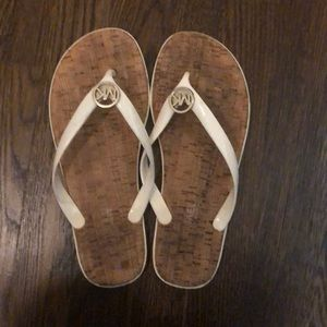Michael Kors white flip flops